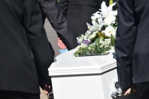 White casket being carried