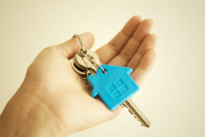 Person holding home keys