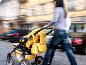 Woman pushing child in stroller