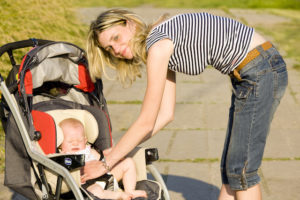 Woman with baby on stroller