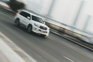 White SUV on highway