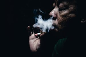 Older man smoking