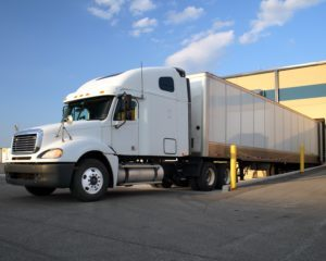 White semi truck at loading dock