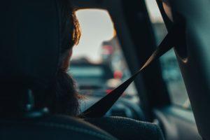 Woman in passenger seat wearing seatbet