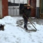 Woman shoveling snow