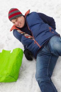 Man slips on icy sidewalk