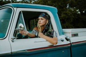 Young woman driving pickup truck