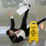 Business man slips on wet floor
