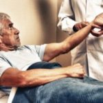 Older man getting his pulse taken