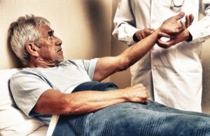 Older man getting his pulse taken