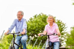 Older couple on bike
