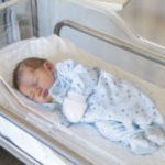 Newborn boy in crib