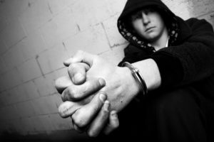 Handcuffed teenager