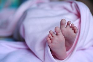 Newborn girl's feet