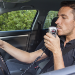 a man using a breathalyzer, accident lawyers