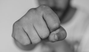 close up of a fist, workers comp lawyer