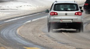 driving on winter road, car accident lawyer
