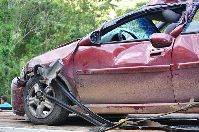 A seriously crashed car on roadside