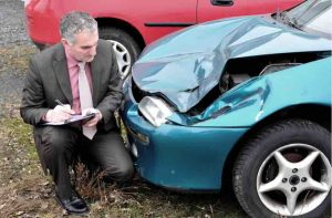 Businessman is documenting a car accident