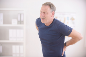 Man feeling back pain