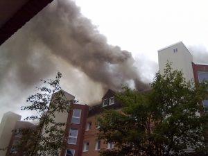 Apartment building on fire, big smoke