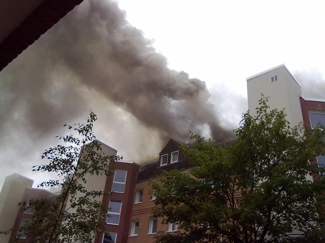 Apartment building on fire, big smoke