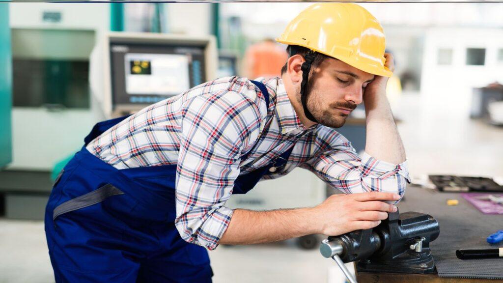 Fatigued worker rest on work desk