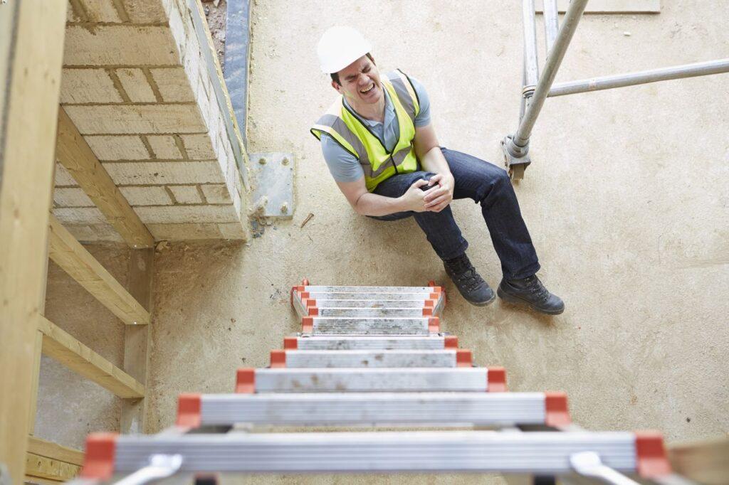 construction worker falling off a ladder