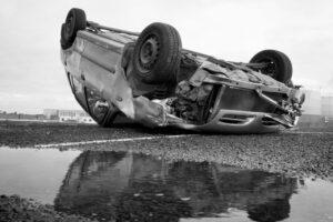 Rolled over car crash, poor pothole