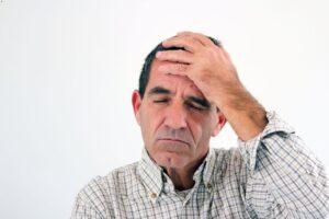 A senior man feels dizziness